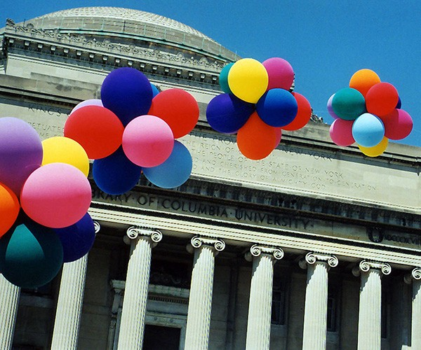 Low Library on Columbia University's Morningside campus with a spray of balloons floating by