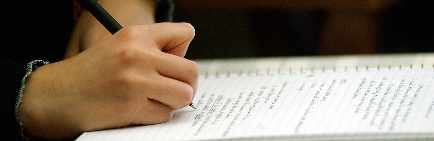 Close up image of student taking a written exam
